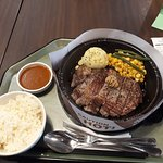 "sizzling ""The Giant"" steak"