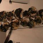 Oysters Rockefeller: spinach, sambuca, parmigiano