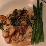 Shrimp with Prosciutto, roasted tomatoes, scallions, smoked bacon over stone ground grits