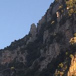 The cliff begins to darken at sunset