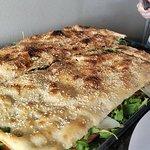 a whole tray of crispy pizza.