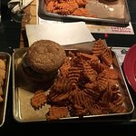 Tater tots, a burger with sweet potato waffle fries on the side, a rangoon from the appetizer me