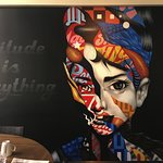 """Attitude is Everything"" Mural on back wall. (This might be Audrey Hepburn)"