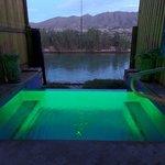 Apache at night (green lights illuminating the pool)
