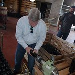 Learning how to seal wine bottles.