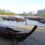 If you wish to travel  for a day trip you can take a long tail boat from Noppharathara Beach.