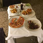 Room service, sorry Int, we always bring our own vinegar. Pizza thin, burger good, beef ribs bet