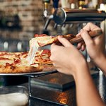 Help yourself to something delicious—Johnny Brusco's New York Style Pizza