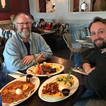 My son and I with a scramble & hash browns, giant banana & brown sugar pancake and meatloaf with