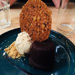 Dark chocolate fondant with salted caramel ice-cream and sesame snap