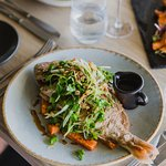 Crispy whole fried snapper with ginger, fried shallots, coriander and 36 Asian dressing