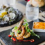 Char grilled king prawns with garlic brulee and fresh chilli