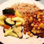 Yellow-tail Snapper with mango salsa, rice pilaf, and mixed veggies