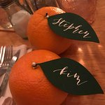 Oranges we used as escort cards for dinner place settings during Floridian wedding reception
