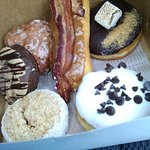 Apple fritter, maple bacon bar, s'mores, PB cup, coffee cake, cookies & cream. DEE-licious!
