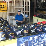 A fellow veteran, manning the cool hat table.