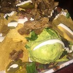 nachos with guacomole and beef