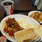 Eggs over easy, paps de la casa, cuban toaast, french toast & coca cola. syrup on the side.