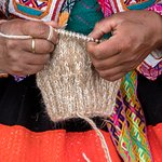 Our artisans knit handspun, undyed alpaca wool to create contemporary knit accessories.