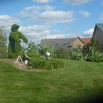 Huge Topiary - Man With Mower Cutting Grass