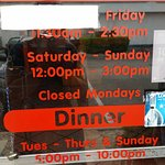 Saffron's hours posted on door