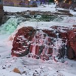 Falls of the Big Sioux River, frozen and illuminated.