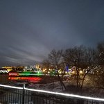 Falls of the Big Sioux River, frozen and illuminated. Plus area around falls.