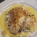 Pecan crusted hogfish, orange rice w/ veggies & sweet curry sauce