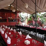 This table was set for another party. The tents provided shade in a lovely garden.