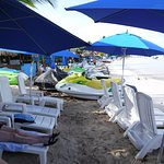 Beach Chairs and umbrellas with nearby Jet Ski rental