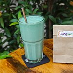 Spirubalada Smoothie with a takeaway bag of treats for traveling. All smoothies 150B