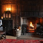 Warm fire in one of the many splendid rooms