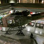 Huey helicopter suspended above other exhibits