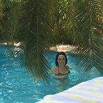 My wife in the pool near the waterfall.