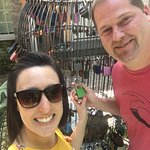 Adding our Love Lock to the bird cage out in the pool deck area