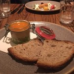 potted crab with salmon starter in the distance