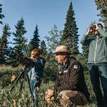 Using the spotting scope and binoculars on a wildlife viewing tour in Grand Teton
