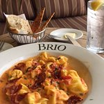 Pasta alla Vodka and bread basket at Brio.