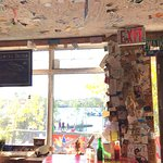 name cards and post cards from all over the world on walls and ceilings