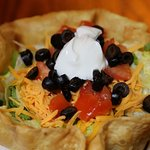 Taco salad served in a tortilla shell.