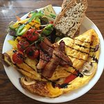 Brunch omelette with crispy bacon and sour dough toasted bread.