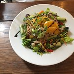 Warmed shredded duck salad.