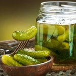 Огурцы соленые (39 рублей за 100 грамм).