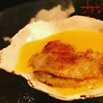 Grilled oyster with coconut sauce