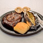 12oz Ribeye with Baked Potato. Voted the Best steak in Maury County 16 years in a row