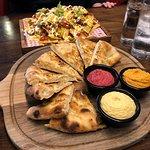 Starters - hummus 3 ways in the foreground, nachos in the background