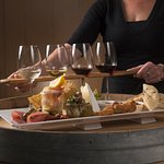 A flight of wine samples (paddle) and our a la carte tasting platter