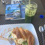 Breakfast croissant and green juice.