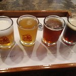 """A """"flight"""" of four beers is a good way to start a visit."""