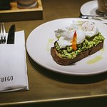 Fuego Breakfast - Crushed avocado on toasted sourdough with chilli, lime and poached eggs